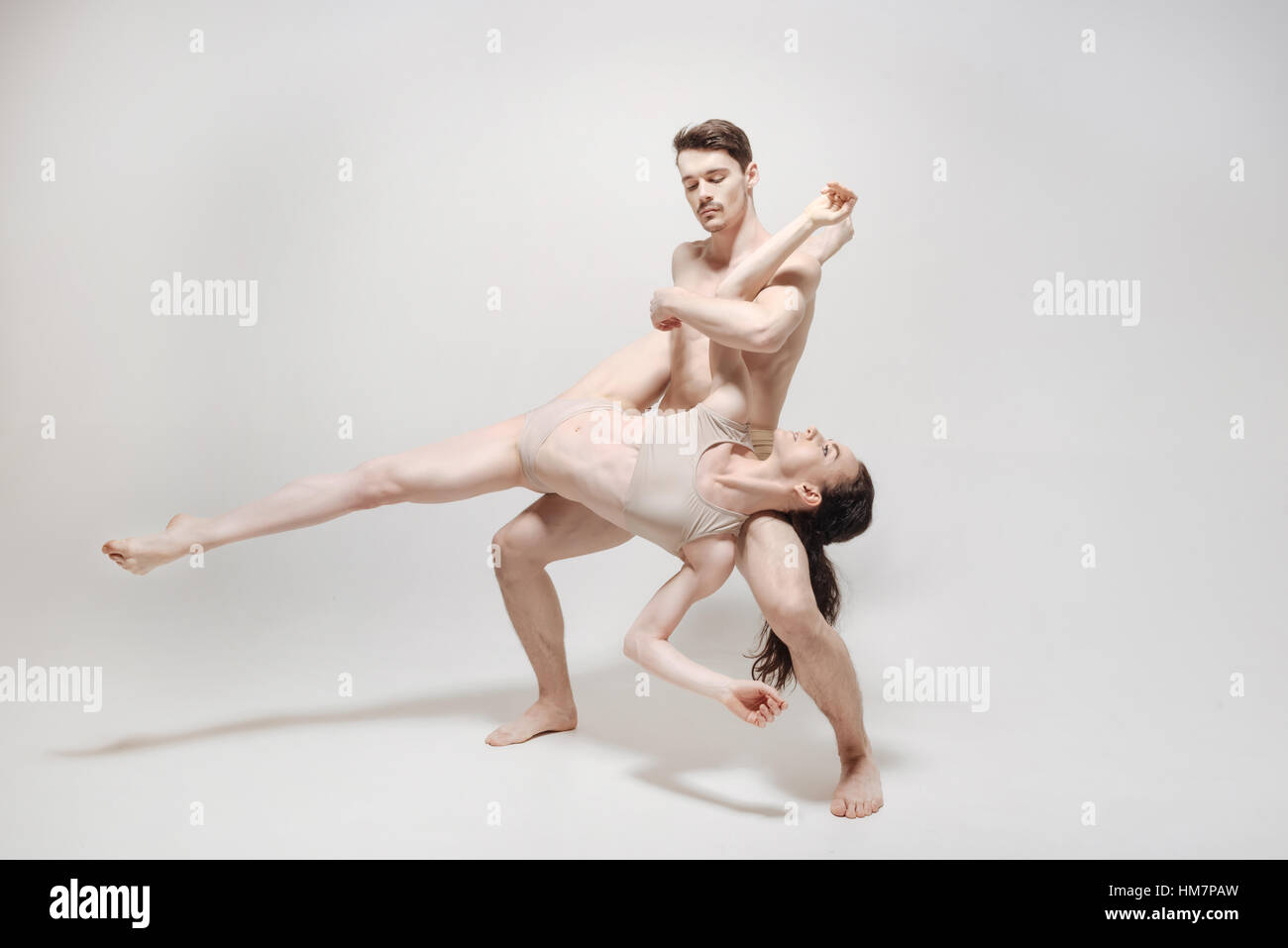 Flexible young dancers training in the white room - Stock Image
