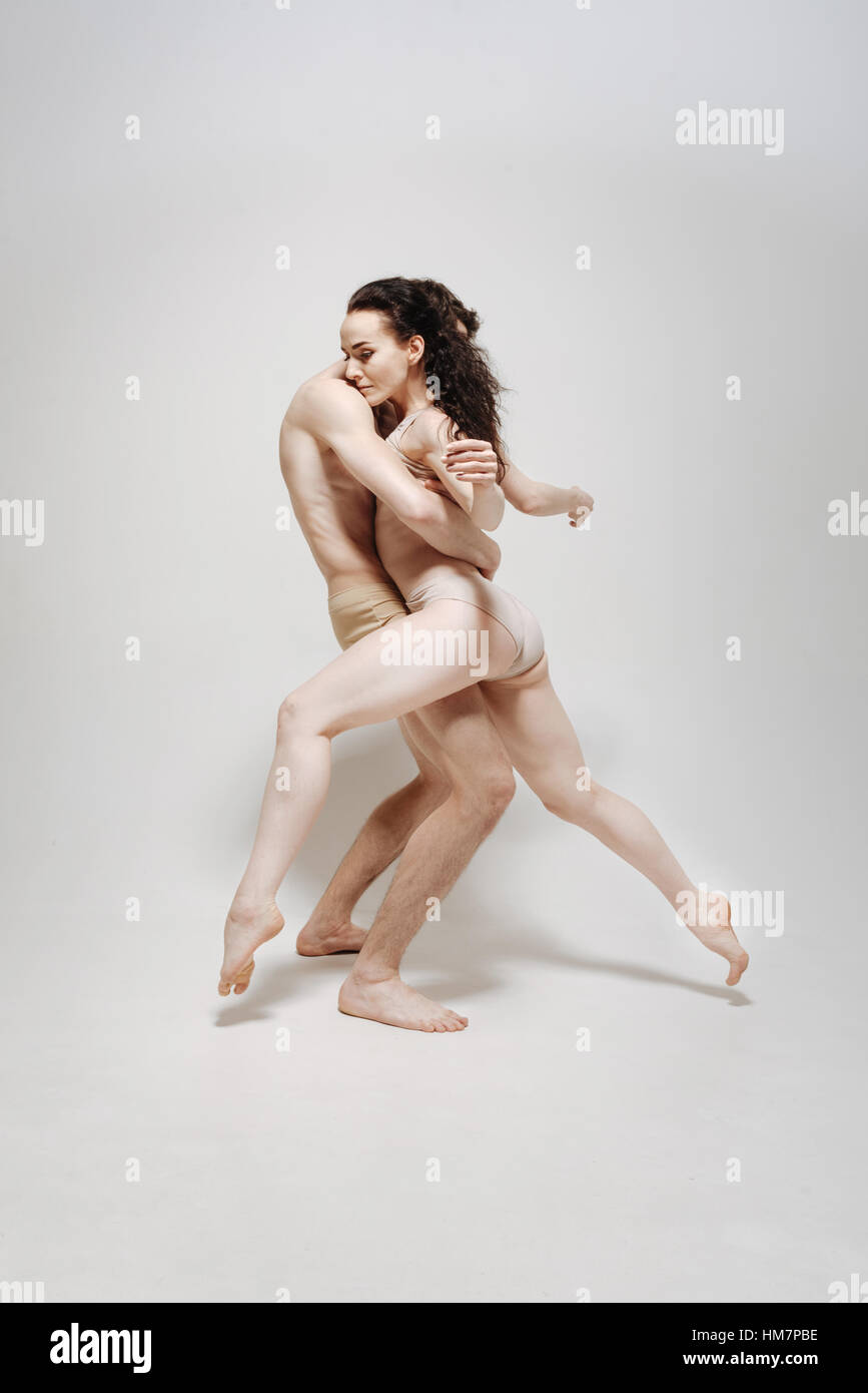 Muscular young athletes posing against white background - Stock Image