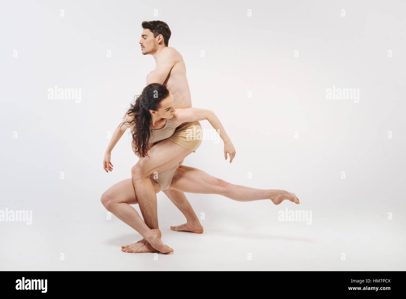 Attractive gymnasts showing their choreography in the studio - Stock Image