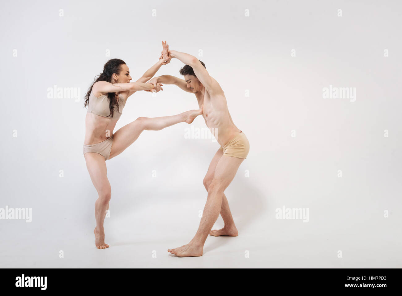 Enthusiastic ballet dancers realizing their art ideas - Stock Image