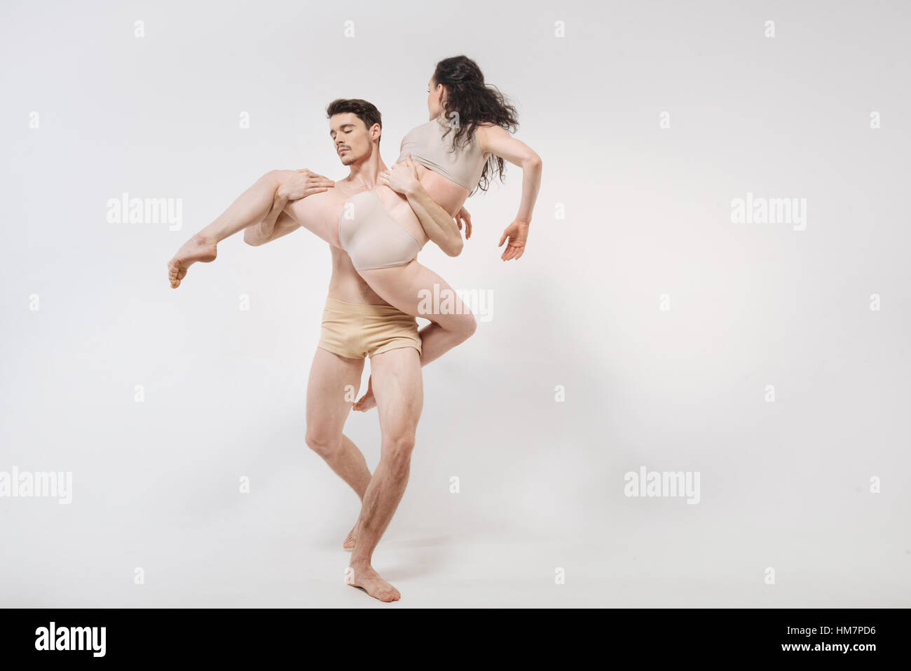 Skilled dancers dancing in close interaction with each other - Stock Image