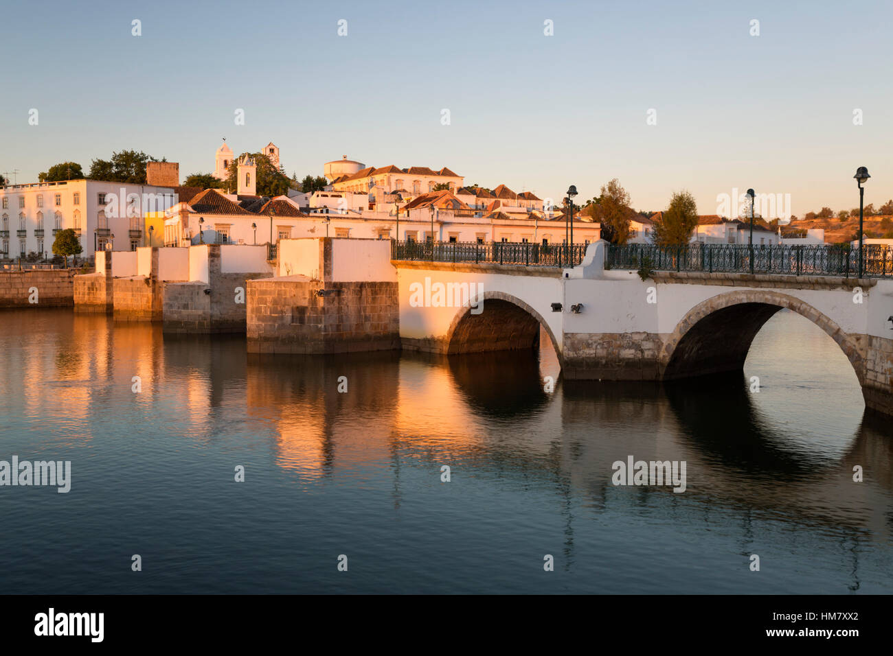 Seven arched Roman bridge and town on the Rio Gilao river at sunrise, Tavira, Algarve, Portugal, Europe - Stock Image