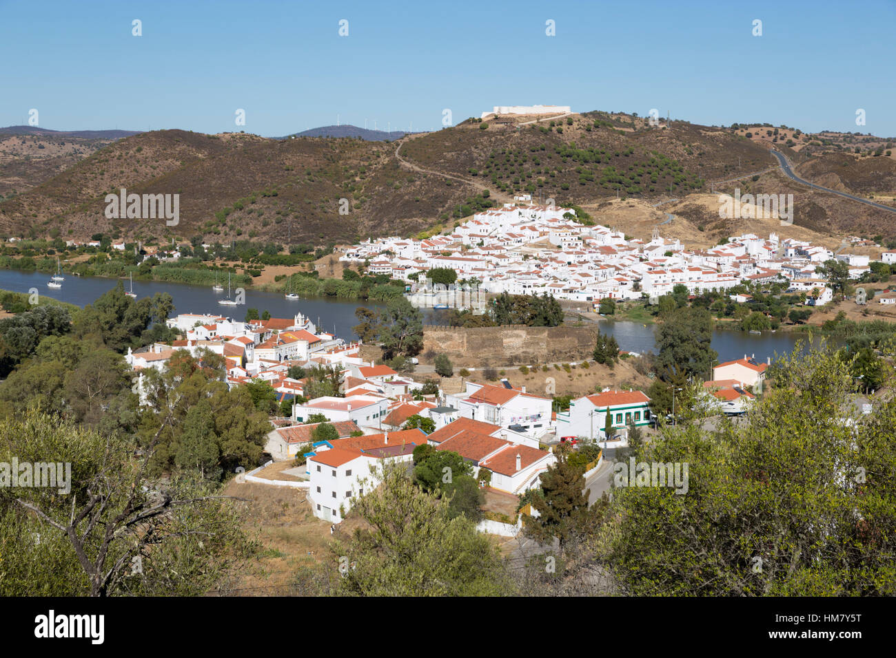 View over Alcoutim and Spanish village of Sanlucar de Guadiana on Rio Guadiana river, Alcoutim, Algarve, Portugal, - Stock Image