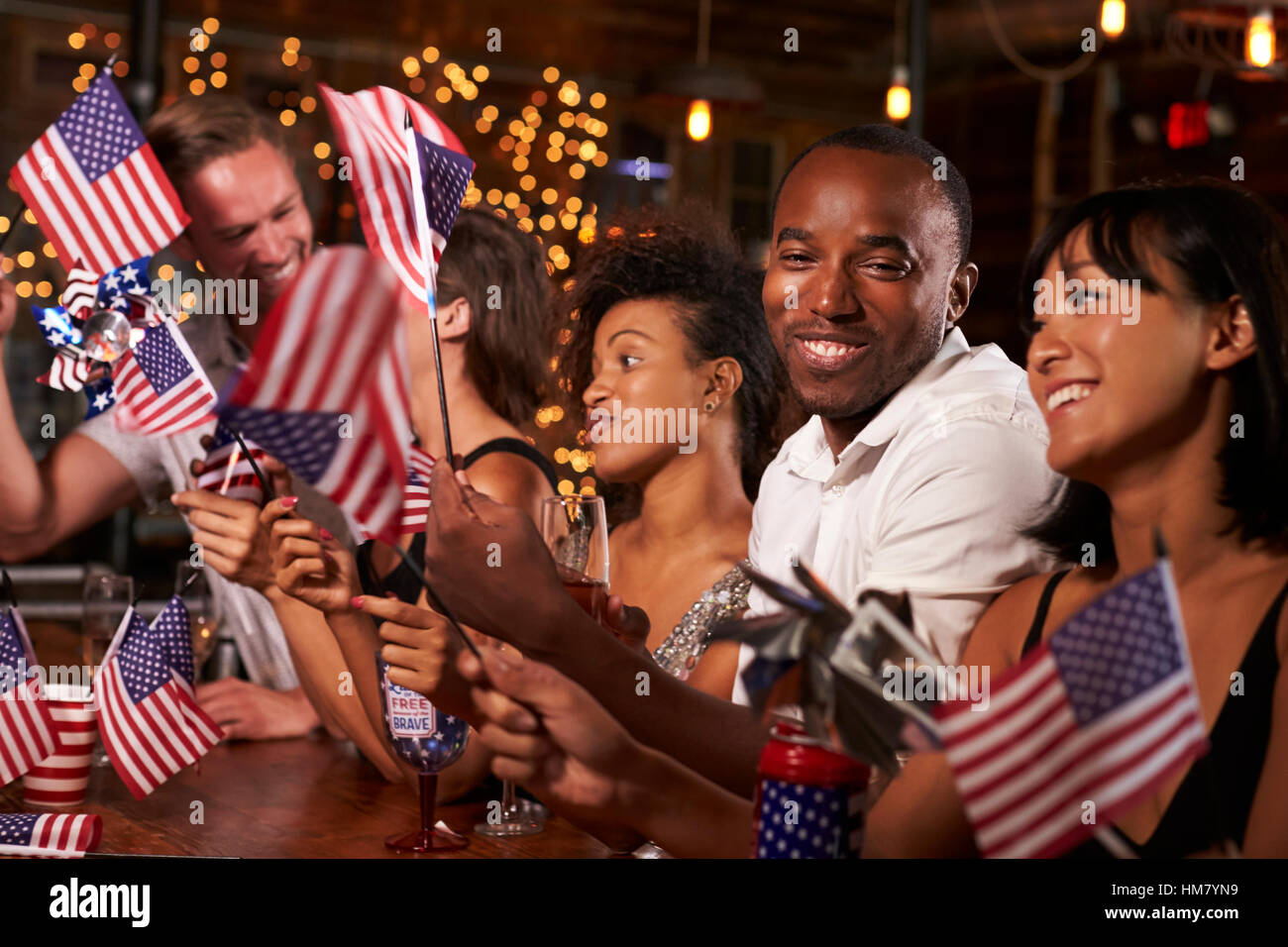 92478486bd Friends celebrating July 4th at a party in a bar Stock Photo ...