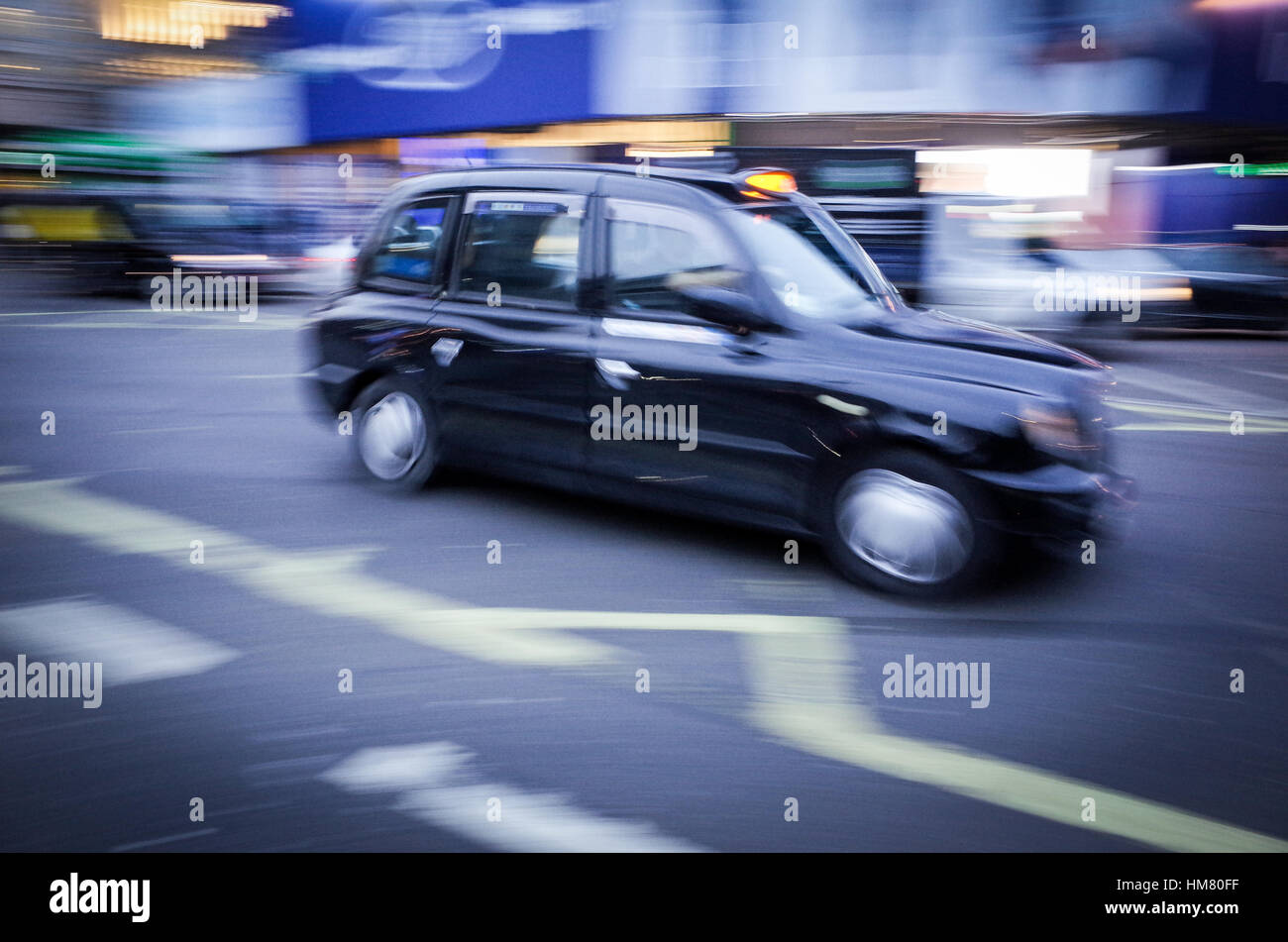 A London taxi in Piccadilly Circus - Motion Blur - Stock Image