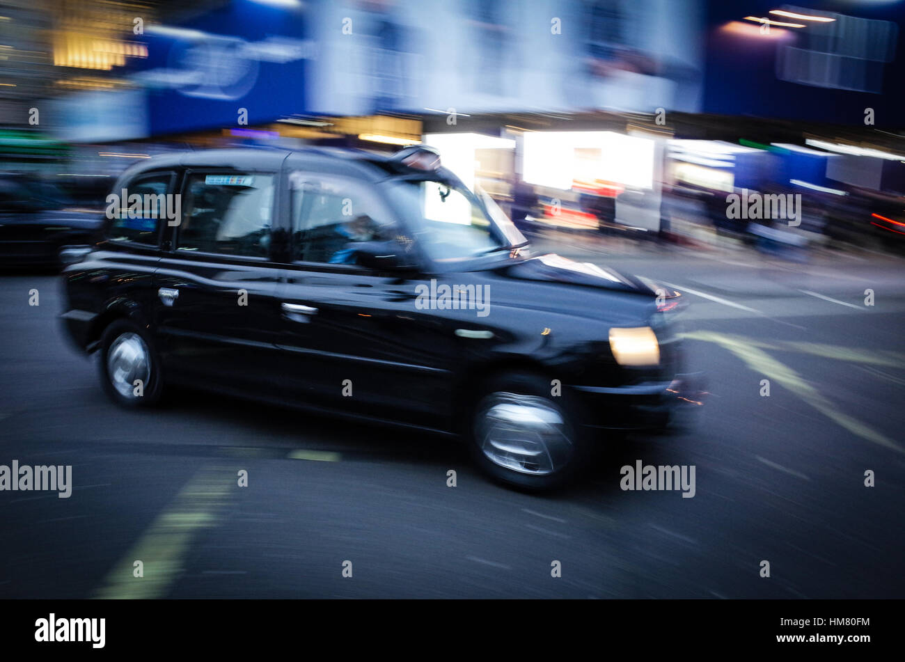 London Taxi Black Cab in Piccadilly Circus - Motion Blur - Stock Image