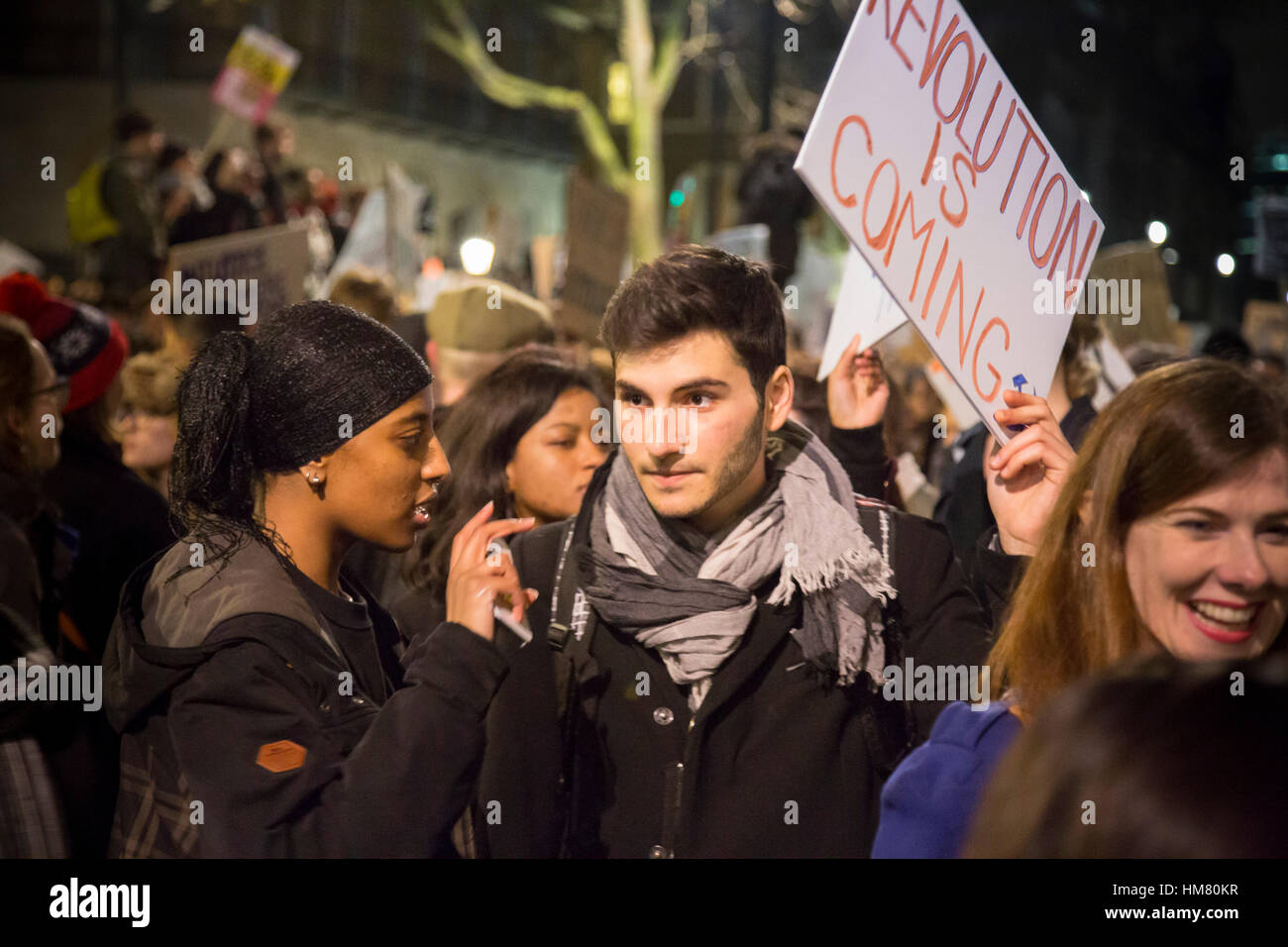 Demonstrators in Whitehall, near Downing Street, protest against US President Trump's entry ban for people from - Stock Image