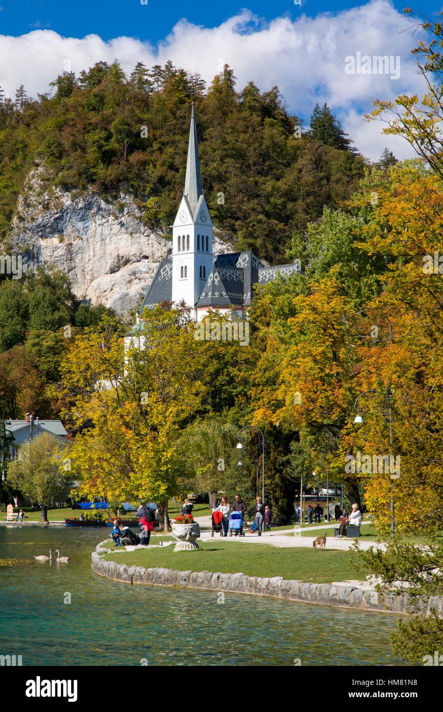Autumn view of St Martins Parish Church along Lake Bled, Bled, Upper Carniola, Slovenia - Stock Image