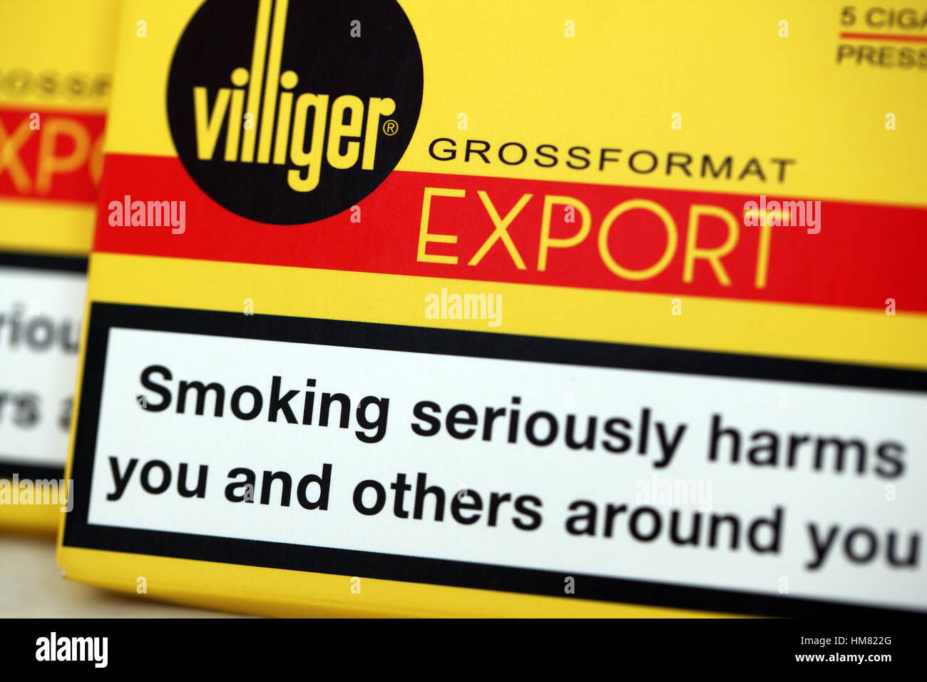 Health warnings on a packets of Villiger cigars - Stock Image