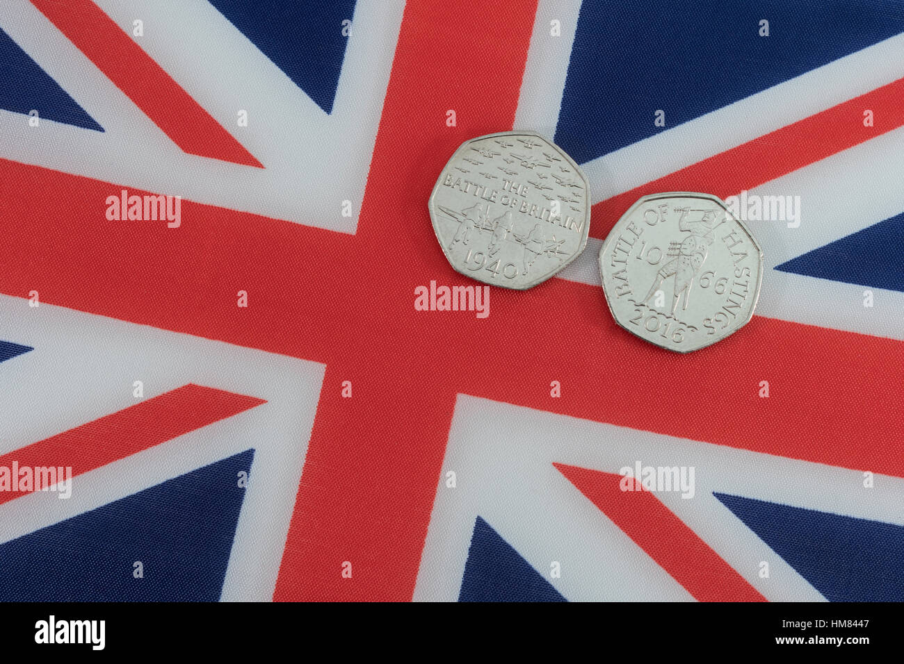 Union Jack with 50p commemorative coins - Battle of Britain and Battle of Hastings - Stock Image