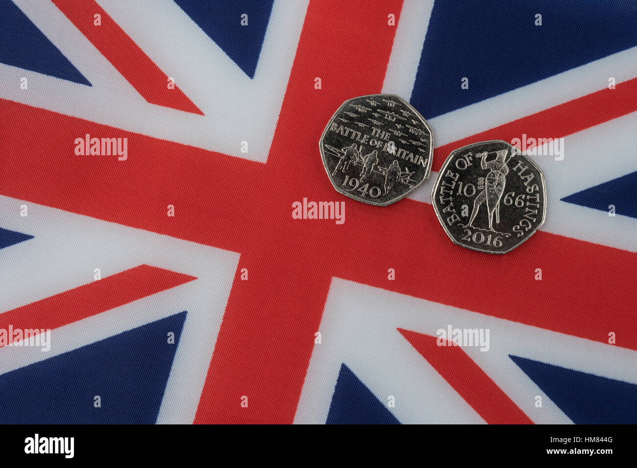 Union Jack with 50p commemorative coins - Battle of Britain and Battle of Hastings Stock Photo