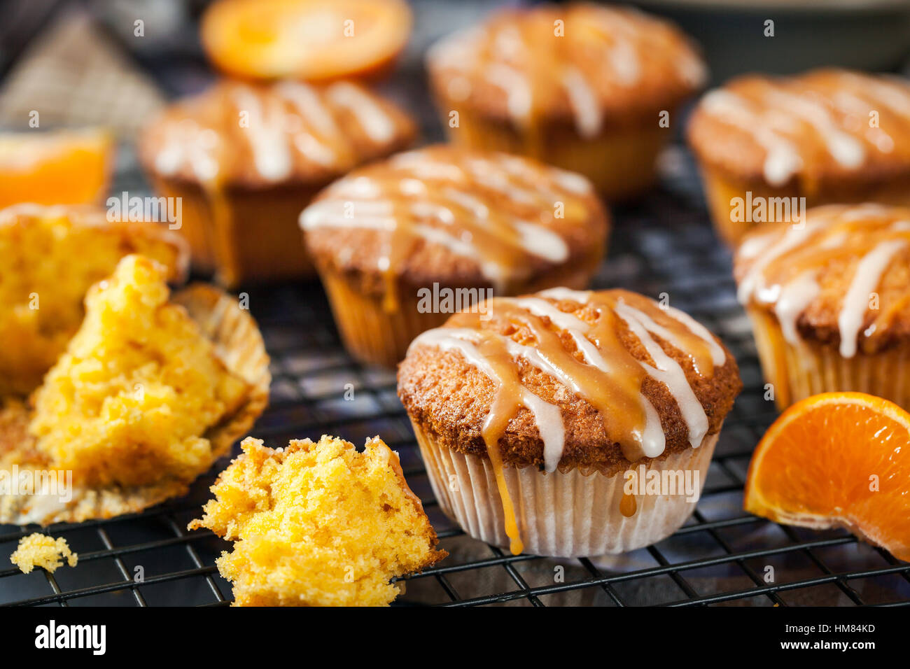 Carrot tangerine cupcakes decorated with glaze and caramel topping - Stock Image