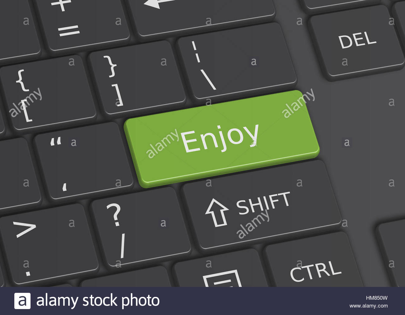 The word Enjoy written on a green key from the keyboard - Stock Image