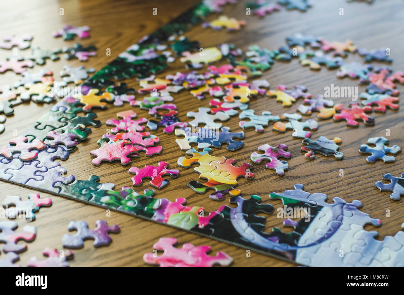 Jigsaw Puzzle and Pieces in Progress - Stock Image