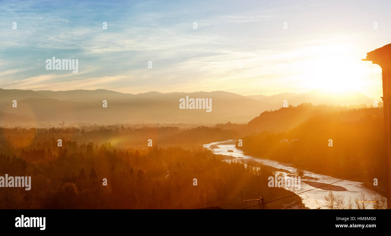 Bolzano, Italy - view of forest, mountains and creek near Bozen at sunset - Stock Image