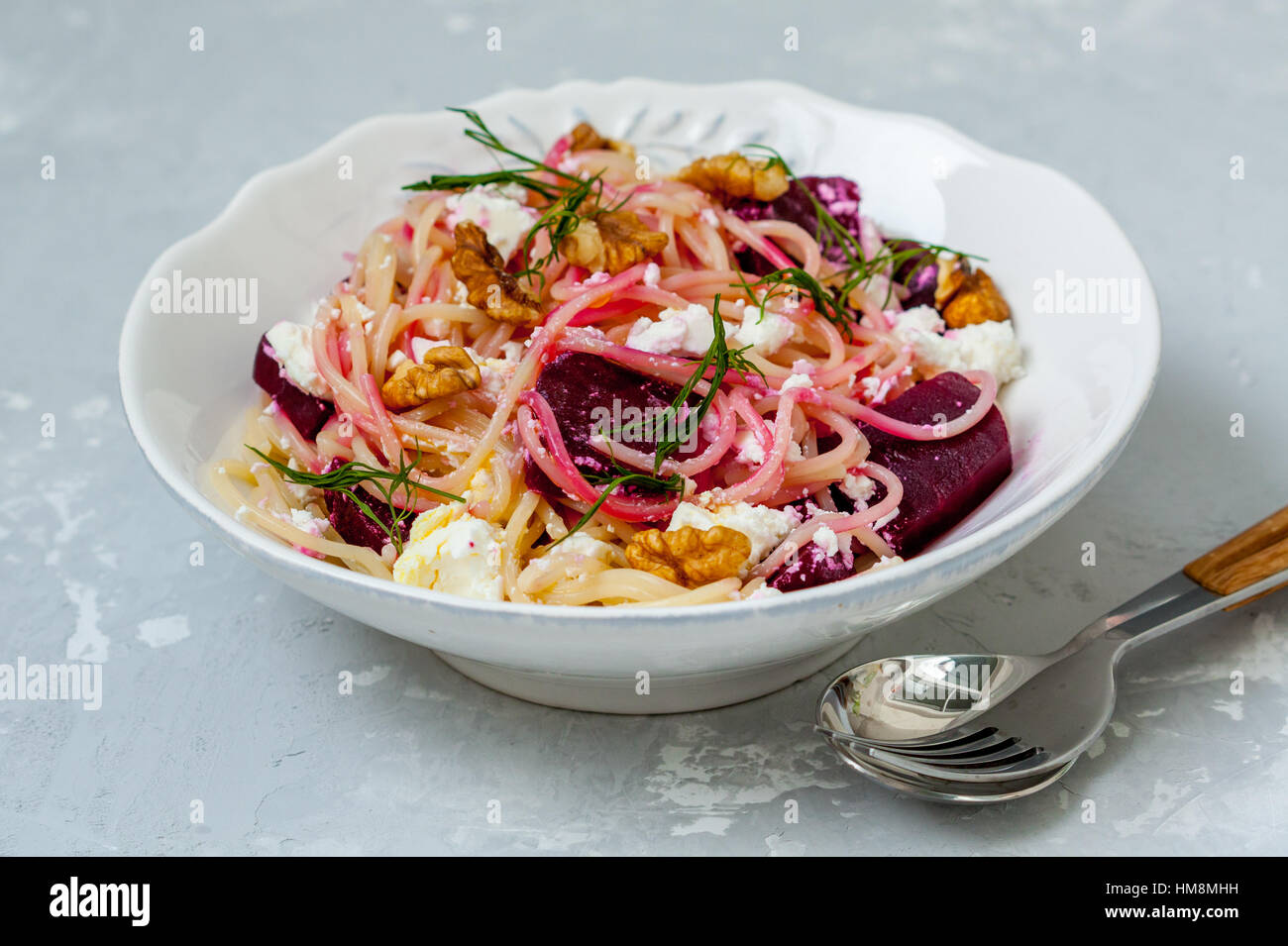 Spaghetti with feta, walnuts and beetroot. Love for a healthy food concept - Stock Image