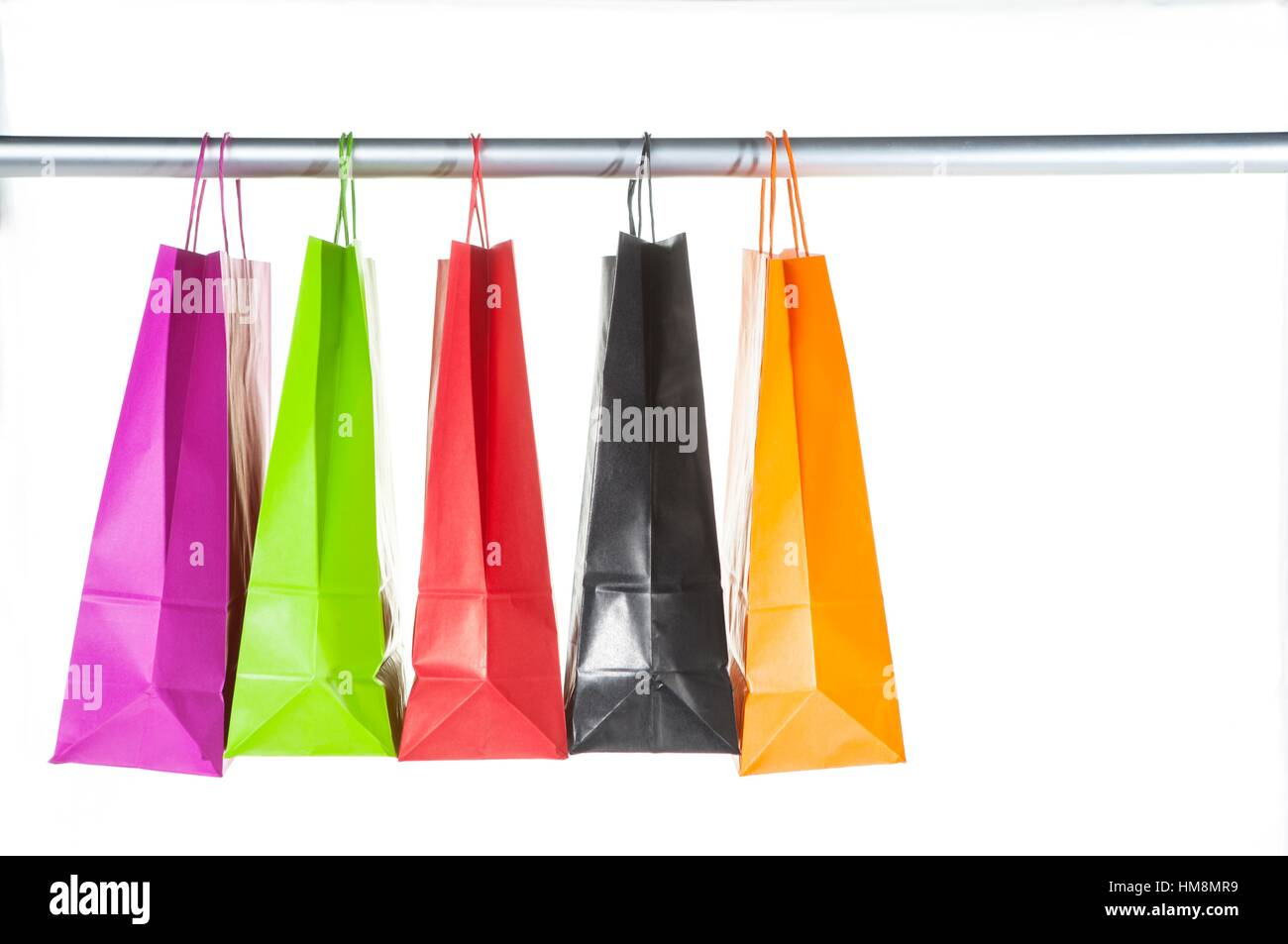 colorful bags hanging on a bar,.estudio cabinet, Valencia - Stock Image