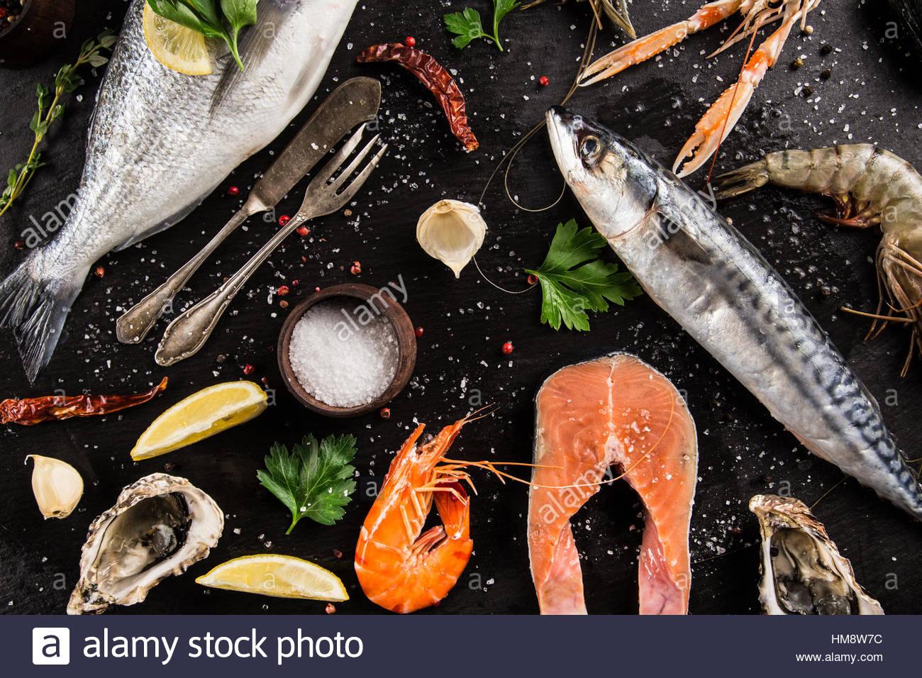 Fresh seafood on black stone, close-up. - Stock Image
