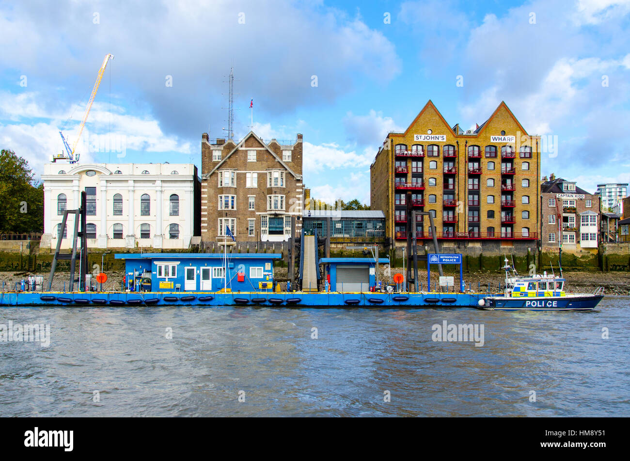 Wapping Police Pontoon and Station is the HQ and operating base of the Metropolitan Police Marine Policing Unit - Stock Image