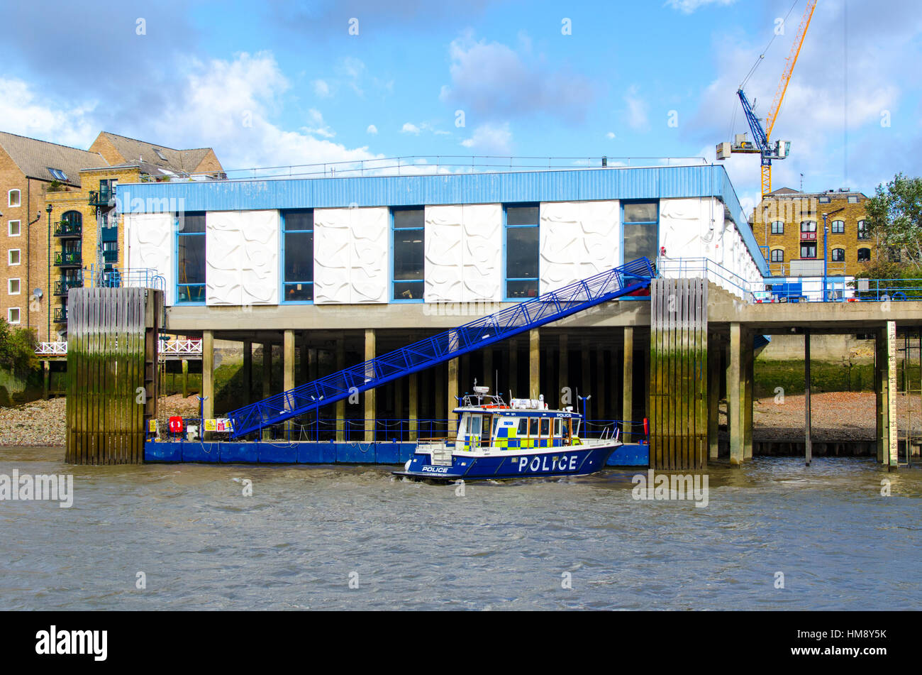 Metropolitan Police Marine Policing Unit Workshops, just upstream from their  Wapping Pontoon HQ. - Stock Image