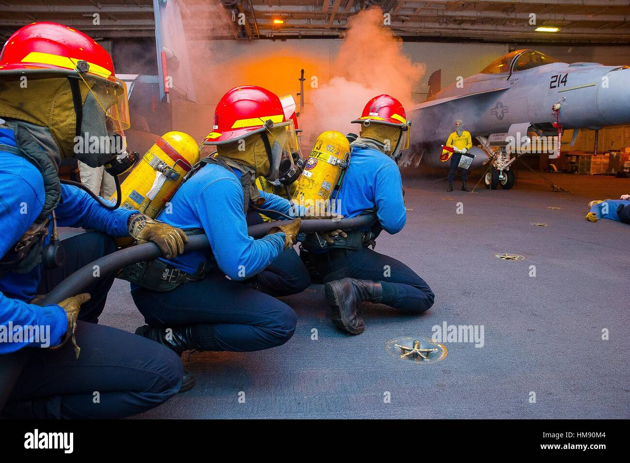 TIMOR SEA (July 7, 2015) Sailors fight a simulated class bravo fire in the hangar bay of the Nimitz-class aircraft Stock Photo