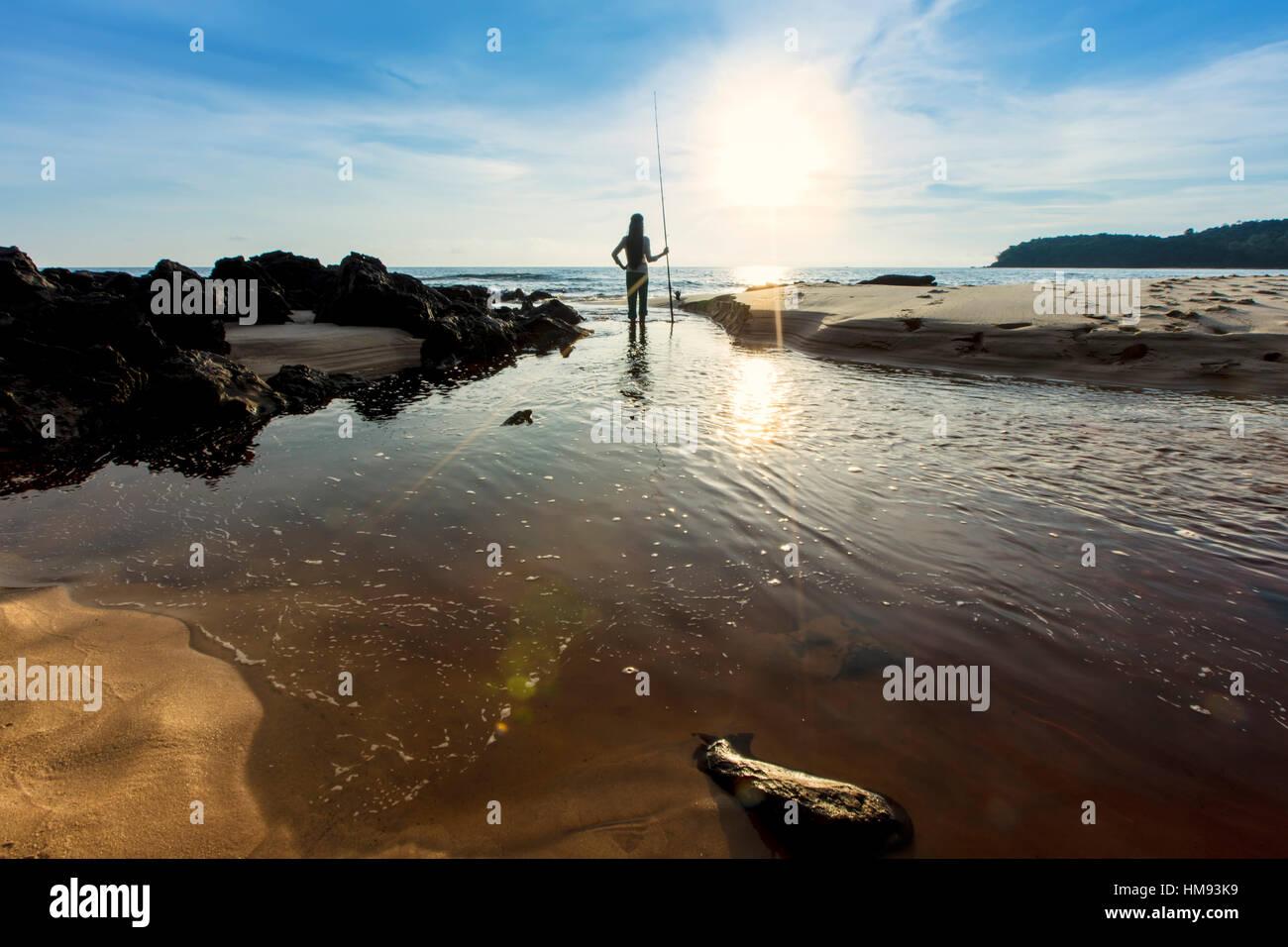 Vietnamese fisherwoman on an island beach near Sihanoukville, Cambodia, Indochina, Southeast Asia - Stock Image