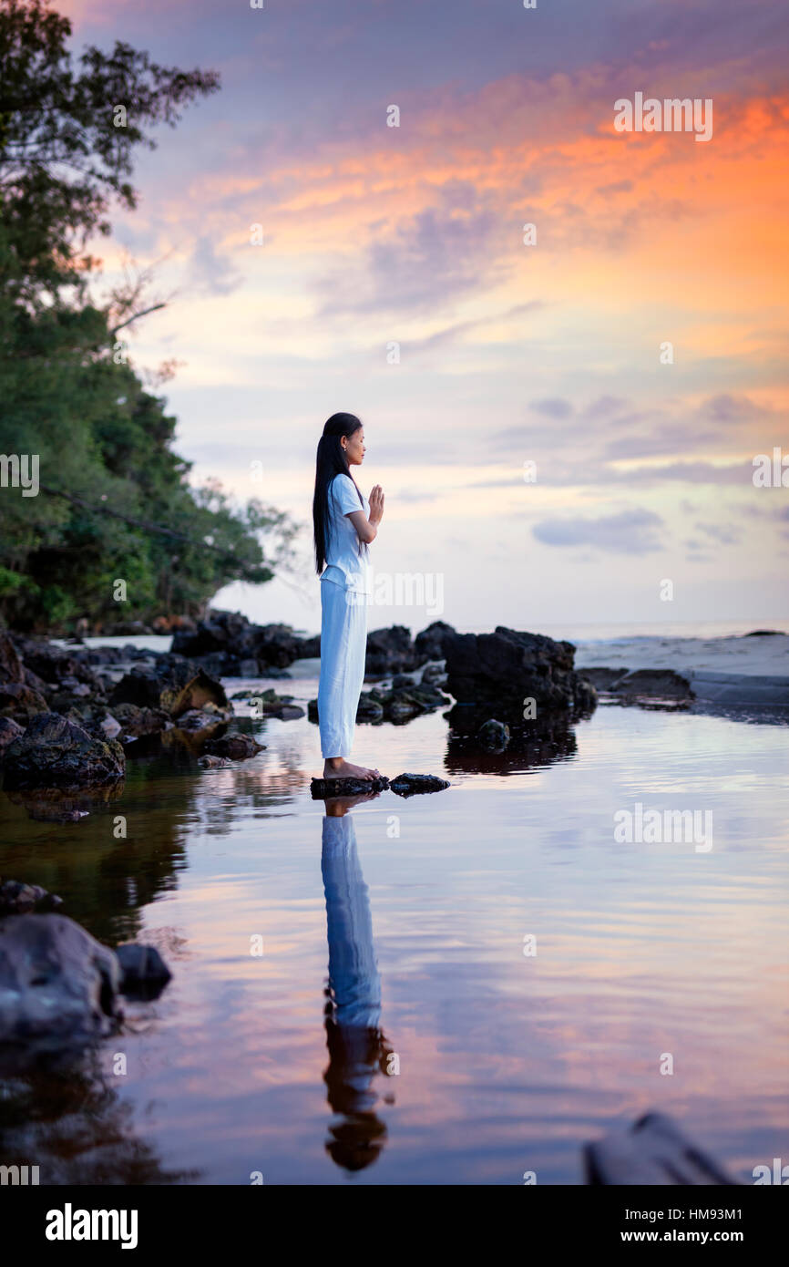Cambodian woman standing in a yoga asana, Sihanoukville, Cambodia, Indochina, Southeast Asia Stock Photo