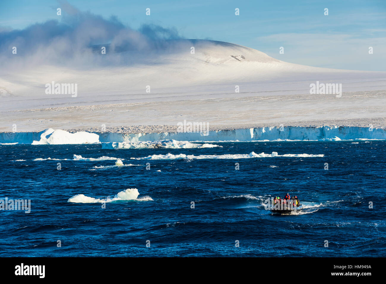 Zodiac with tourists cruising through the icebergs, Brown Bluff, Tabarin Peninsula, Antarctica, Polar Regions Stock Photo