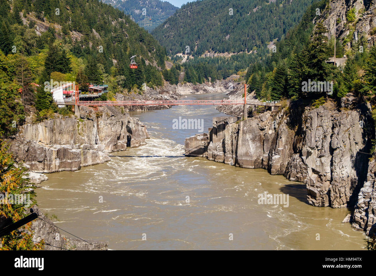 Hell's Gate and Fraser River in British Columbia, Canada. The Air Tram and pedestrian suspension bridge. Stock Photo