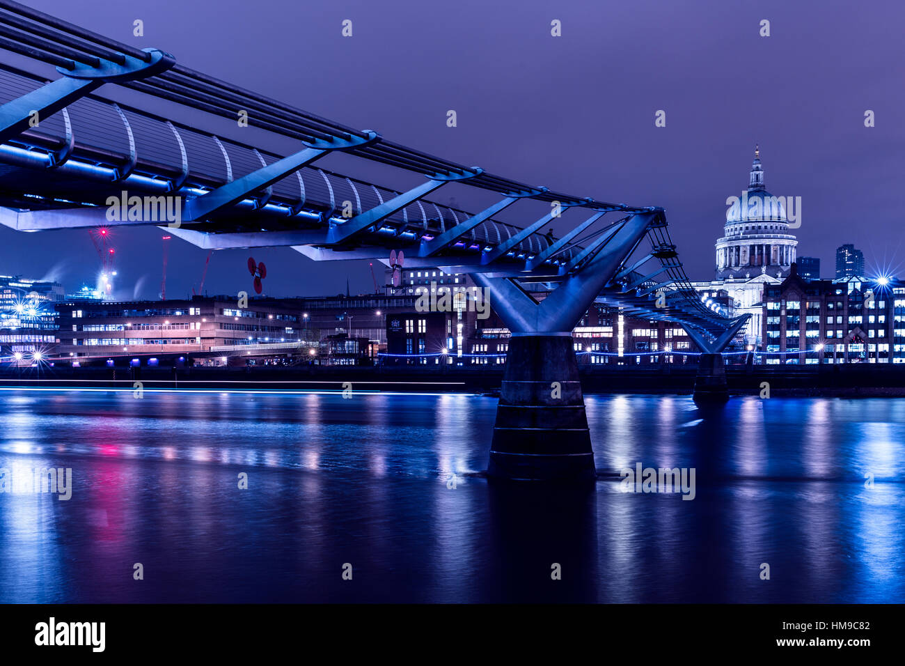 London skyline at night on River Thames with Millennium Bridge and St Paul's Cathedral - Stock Image