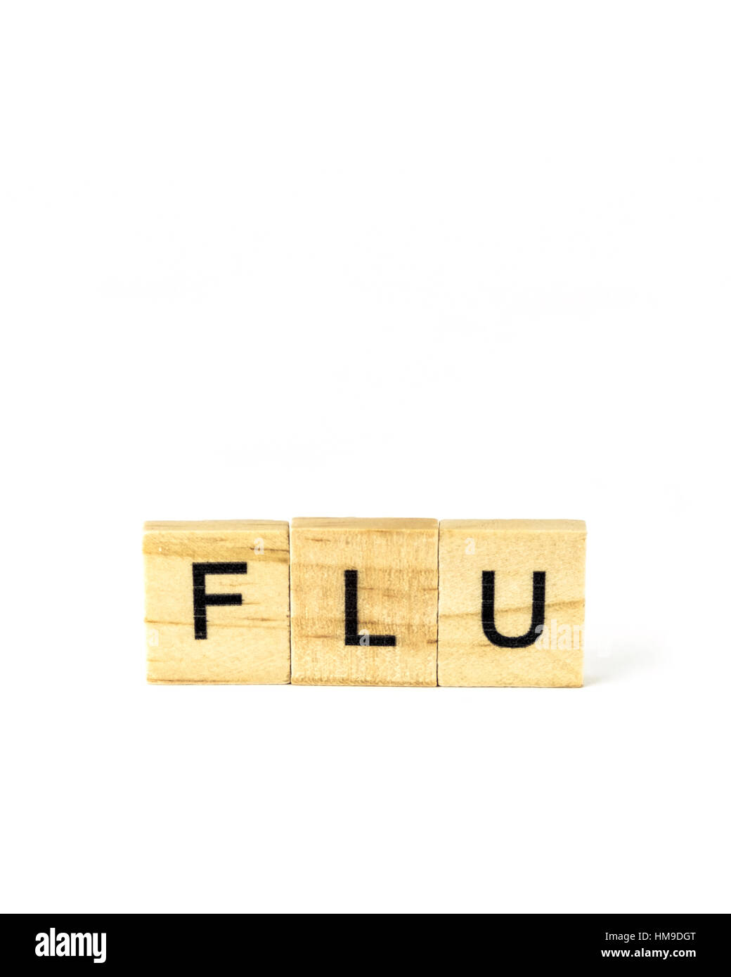 Block letters spelling 'Flu', a desease and health issue. Cutout. - Stock Image