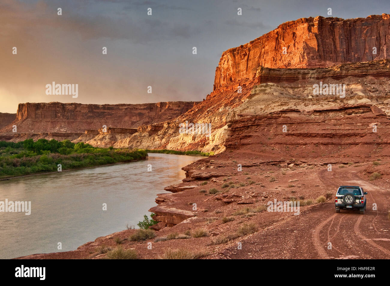 Vehicle in Labirynth Canyon, Green River, view from Labirynth Camp at sunset, White Rim Road, Canyonlands National - Stock Image
