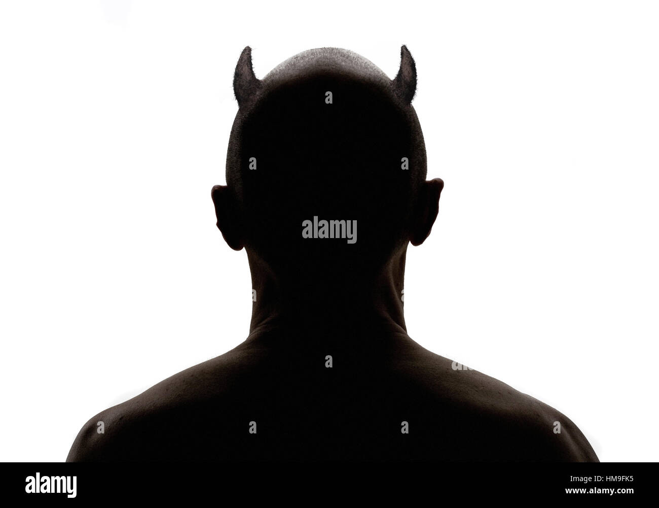 Rear View Silhouette Portrait of Devil with Horns Stock