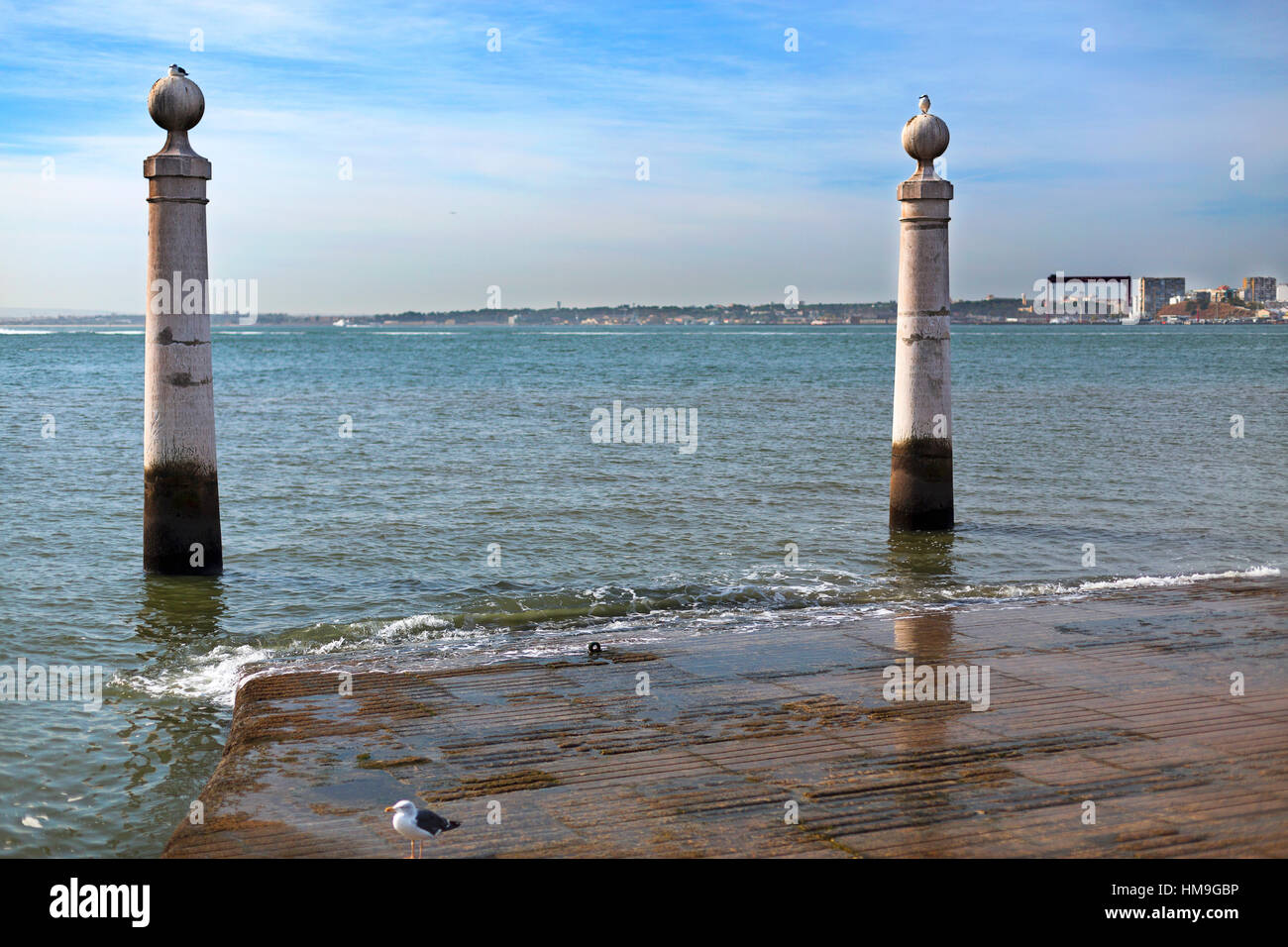 Cais das Colunas is a marble flight of steps, flanked by two water stained marble columns, which runs gently into Stock Photo