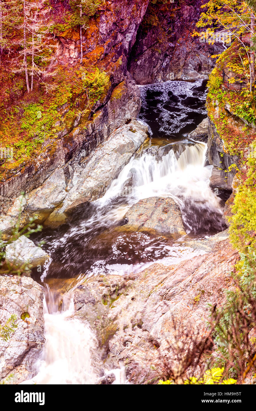 Wonderful autumn colors in Valley - Long exposure view of  wonderful waterfalls in Potholes park, Vancouver island - Stock Image