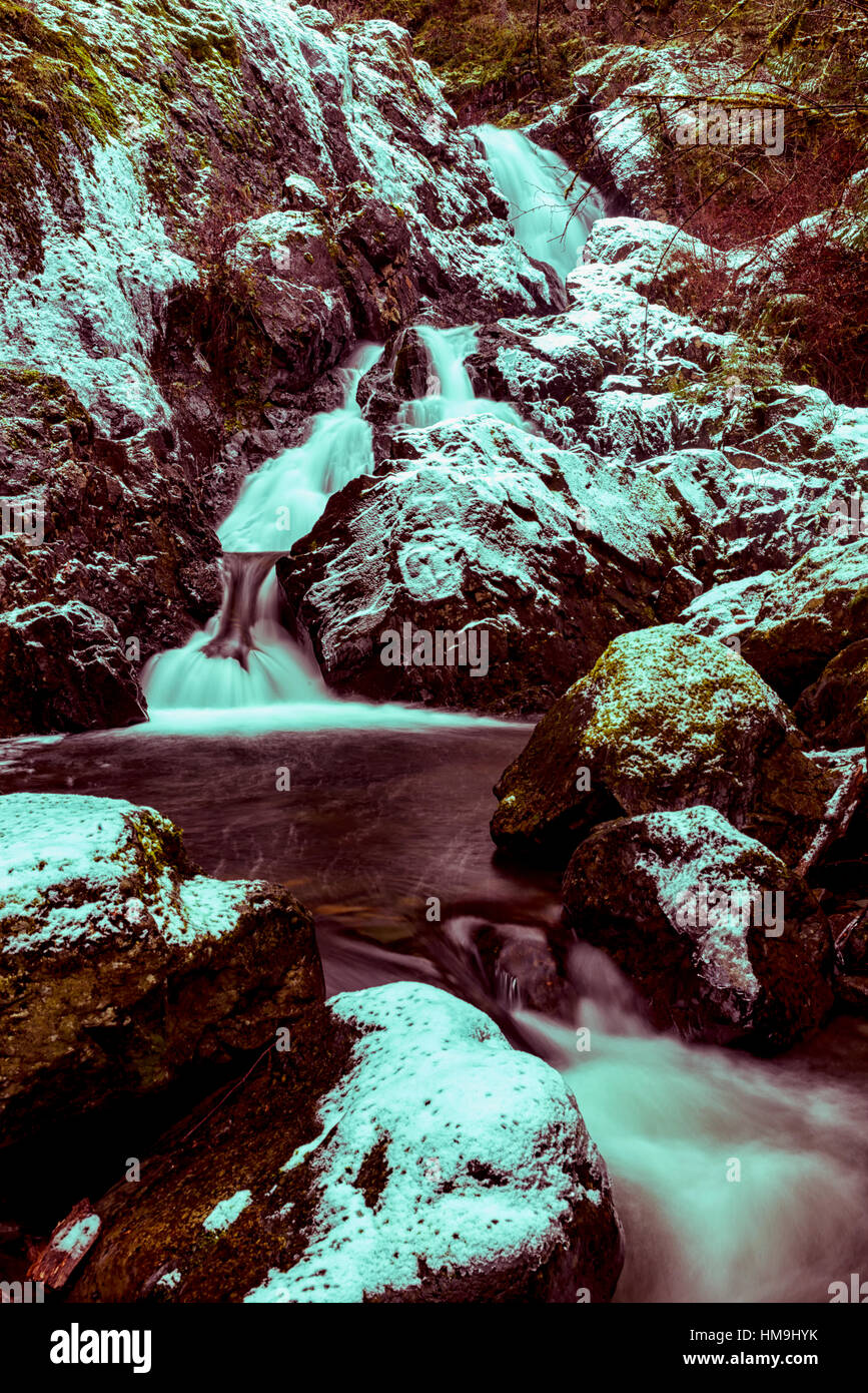 Nature of Vancouver Island - Todd creek waterfalls after first  snow. Potholes provincial park 5. - Stock Image