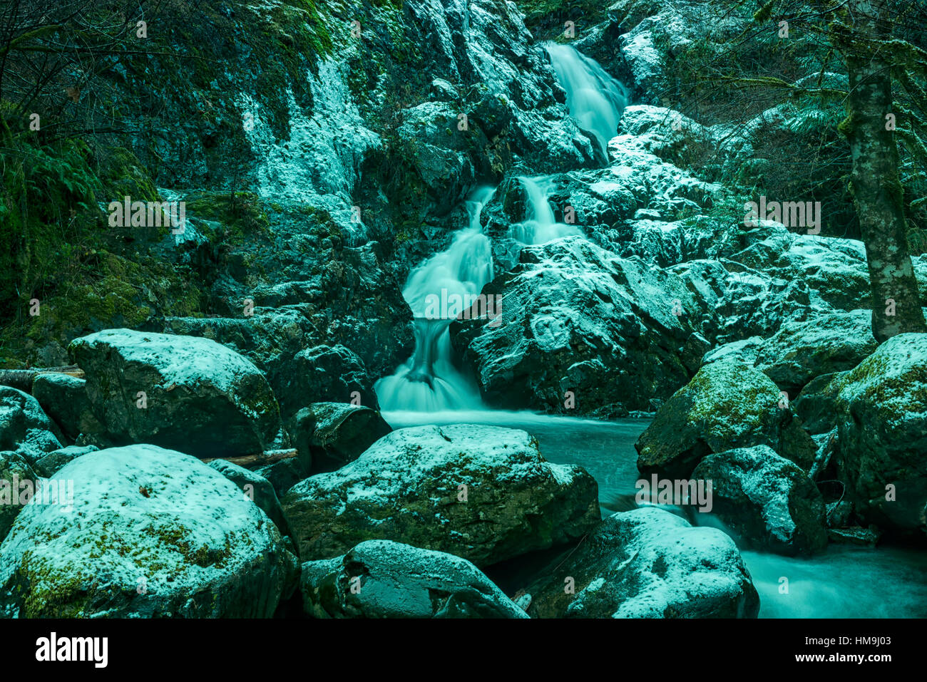 Nature of Vancouver Island - Todd creek waterfalls after first  snow. Potholes provincial park 3. - Stock Image