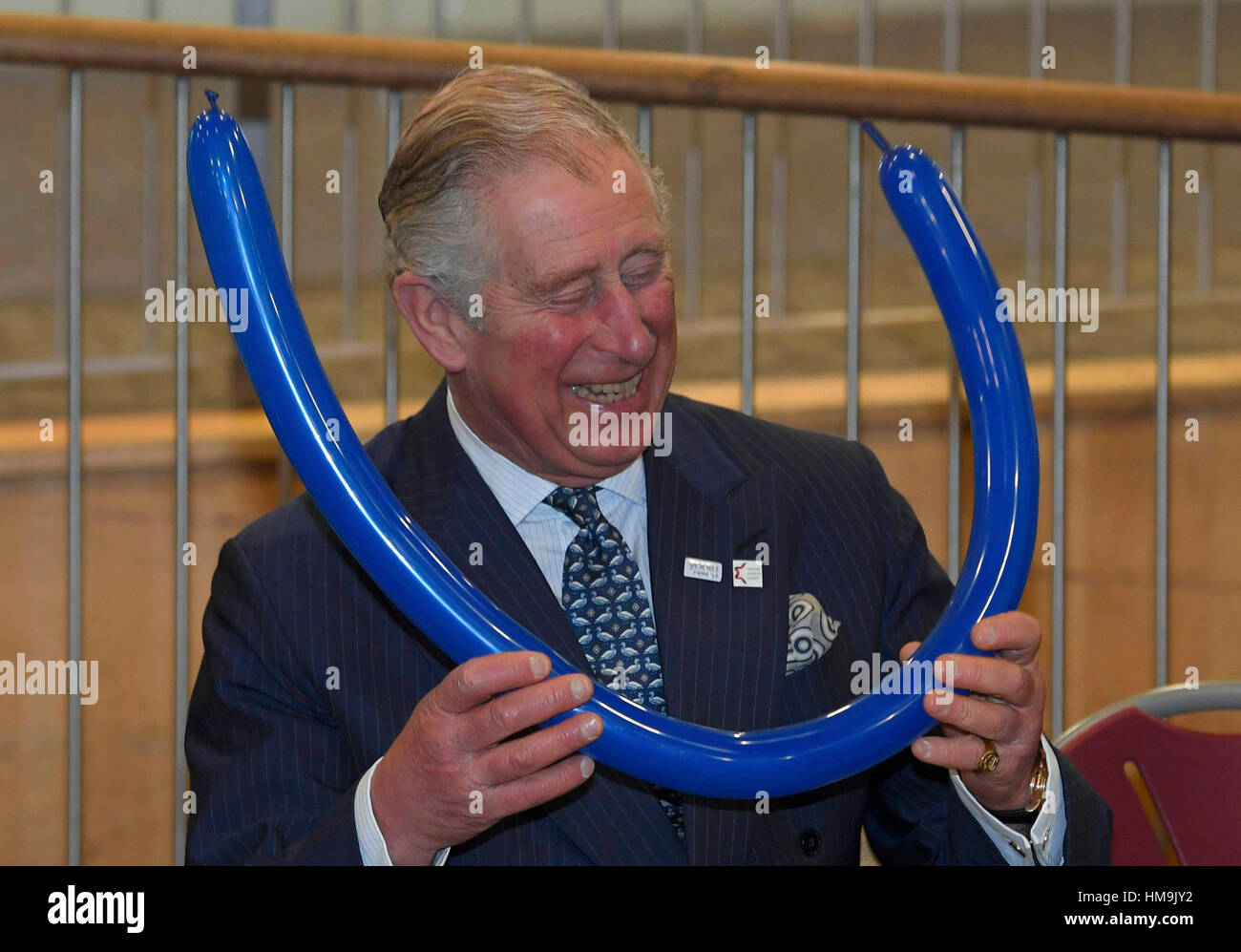 The Prince of Wales is shown how to make headwear from balloons during a  visit to Yavneh College bde90aaef2b