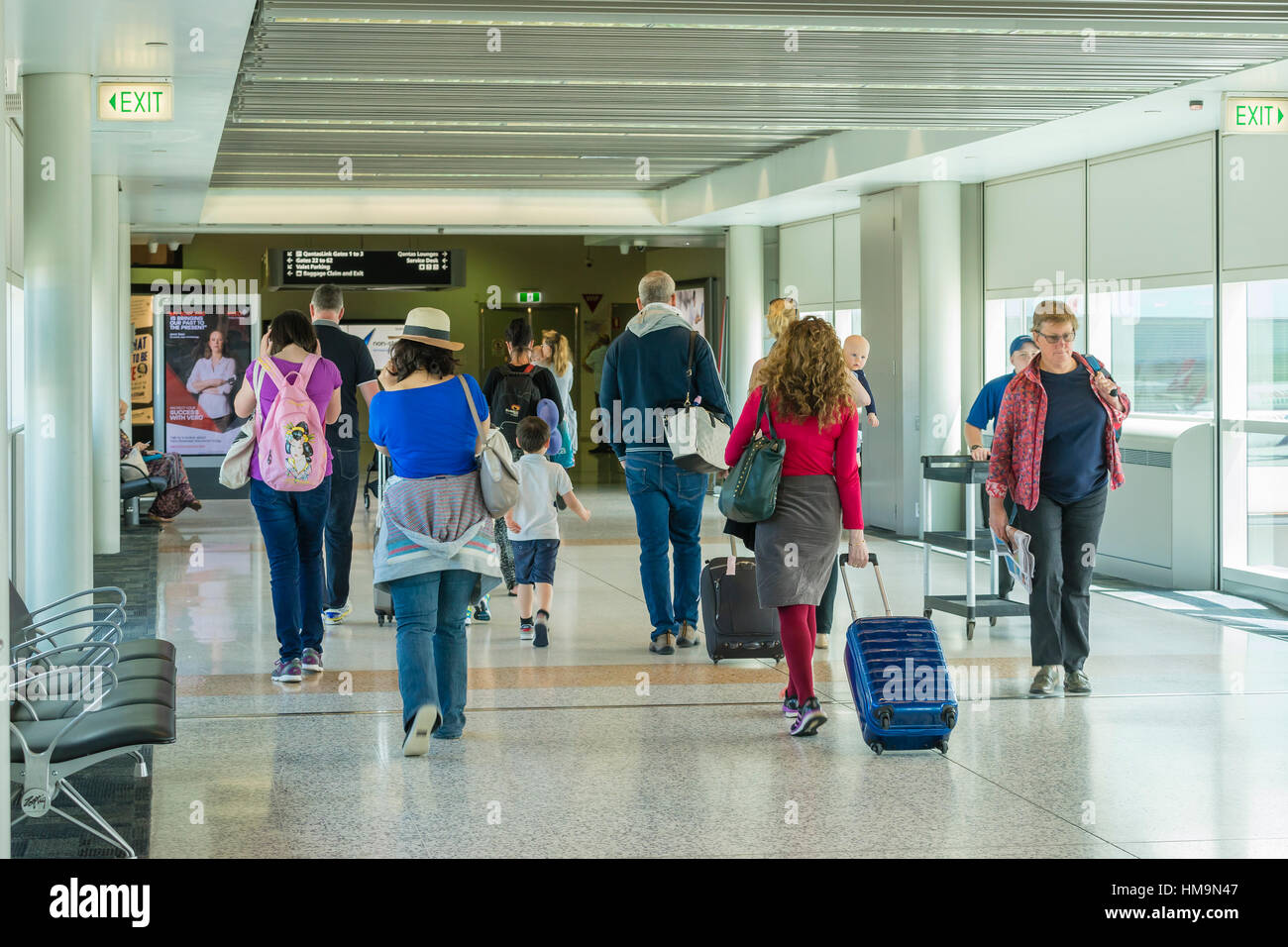 Travellers at airport - Stock Image