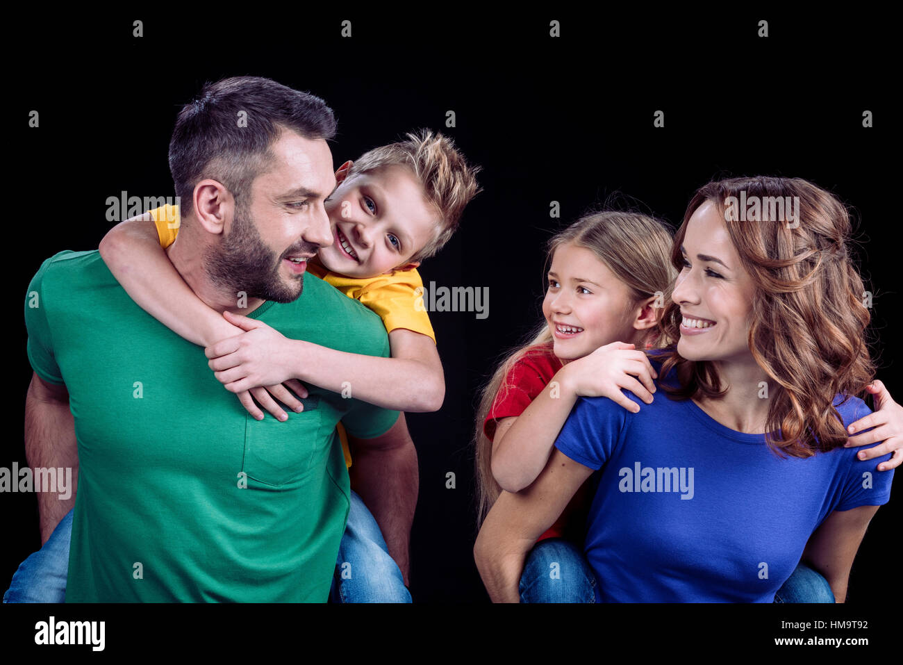 Happy family in colorful t-shirts - Stock Image