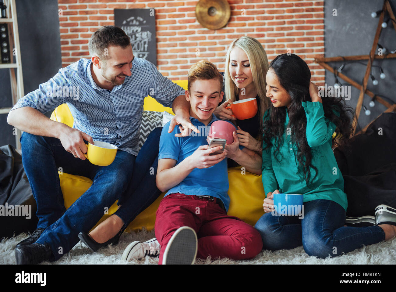 Group portrait of Cheerful old friends communicate with each other, friend posing on cafe, Urban style people having - Stock Image