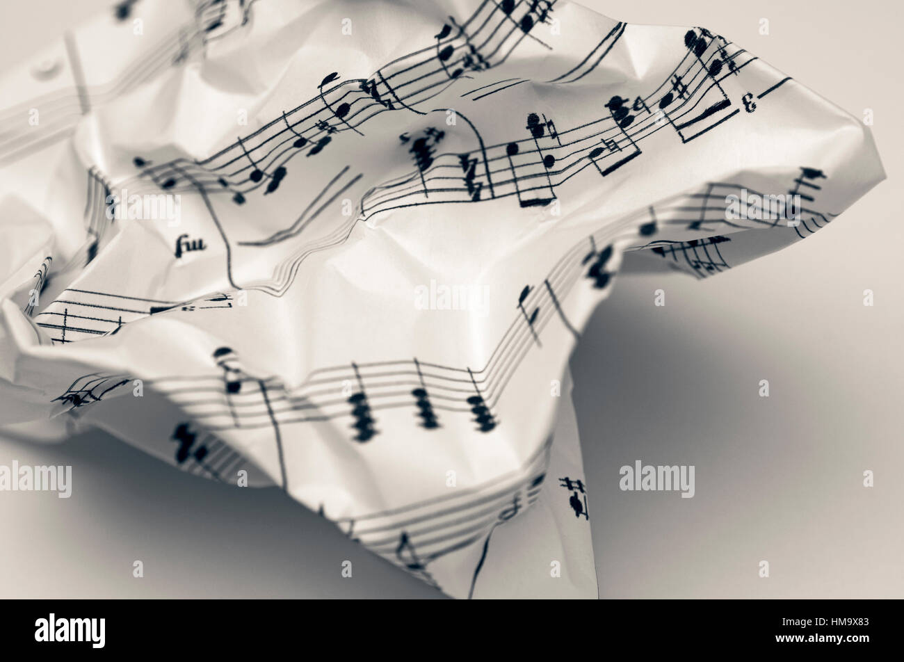 crumpled music sheet - Stock Image