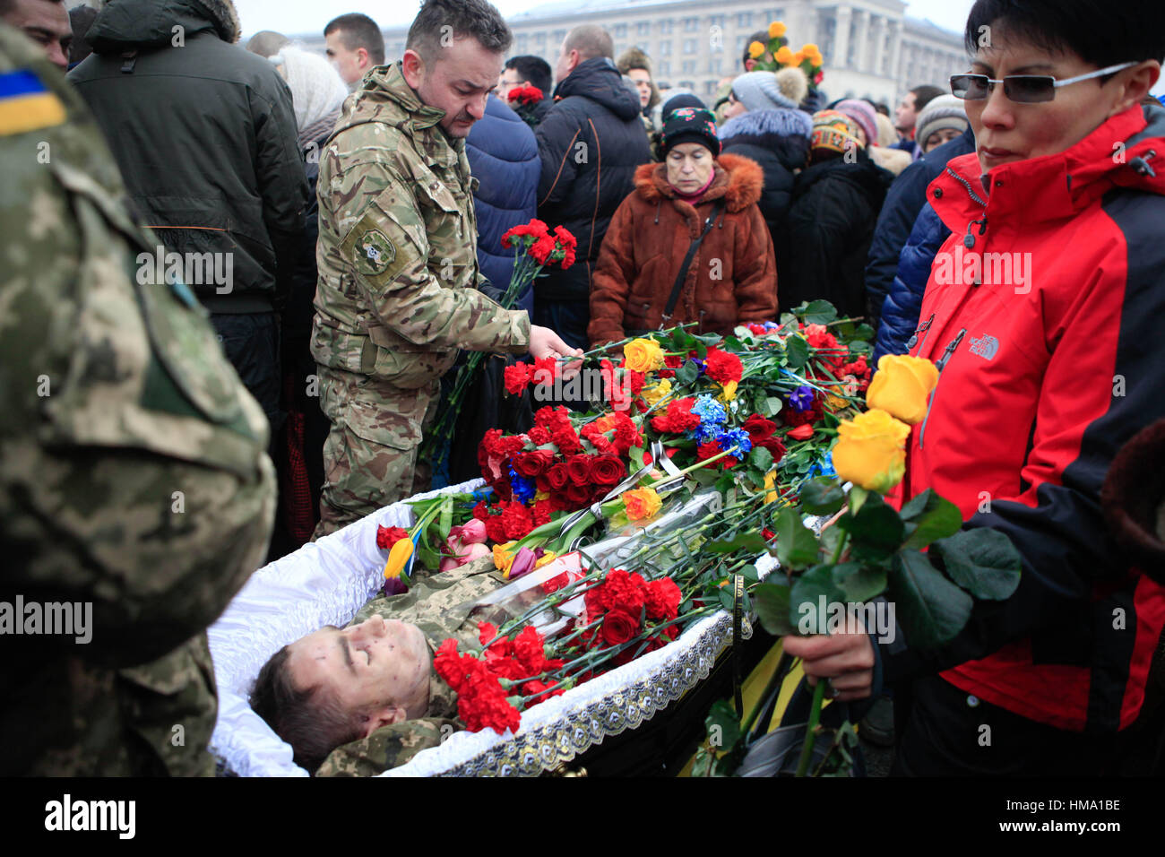 Kiev, Ukraine. 1st Feb, 2017. People take part in a funeral ceremony for the seven Ukrainian servicemen, who were - Stock Image
