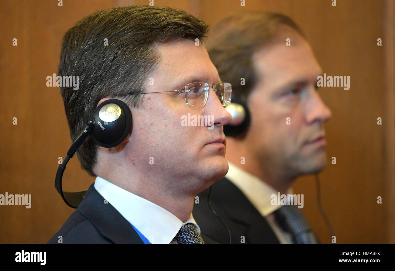 Russian Energy Minister Alexander Novak, left and Minister of Industry and Trade Denis Manturov listen to translations - Stock Image