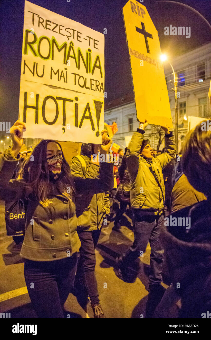 Cluj-Napoca, Romania. 2nd February, 2017. A woman is seen holding a sign that reads Wake up Romania, stop tolerating - Stock Image