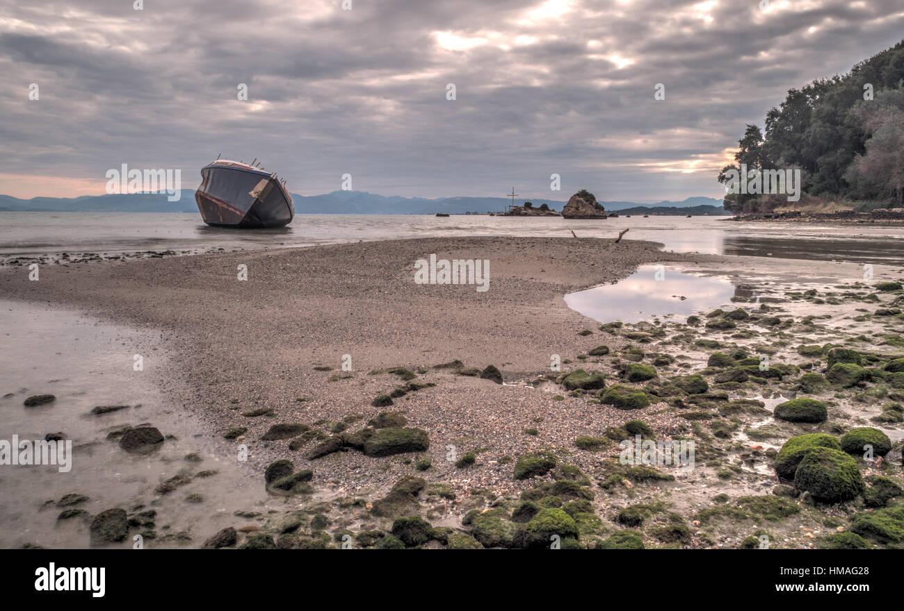 Shipwreck on the beach in South Corfu Greece Europe - Stock Image