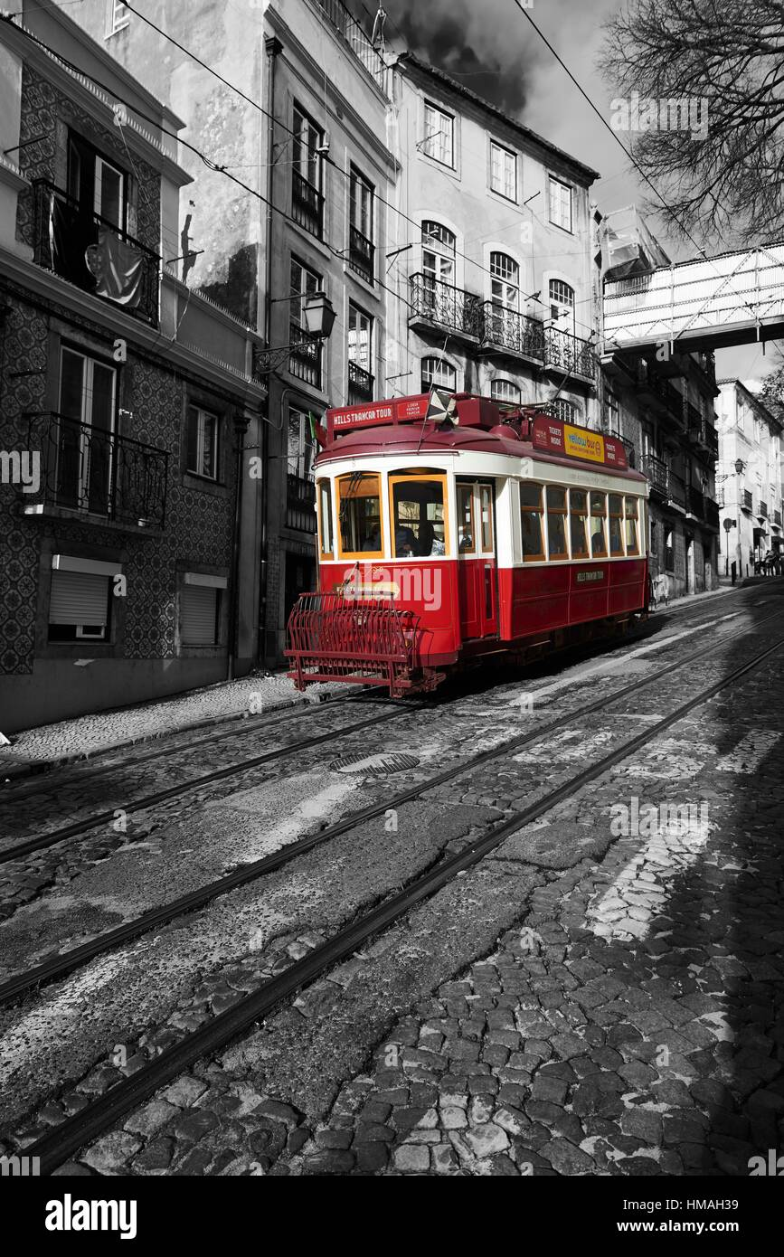 Photograph in black and white mixed with colour of Red Tram in Lisbon, Portugal, Europe - Stock Image