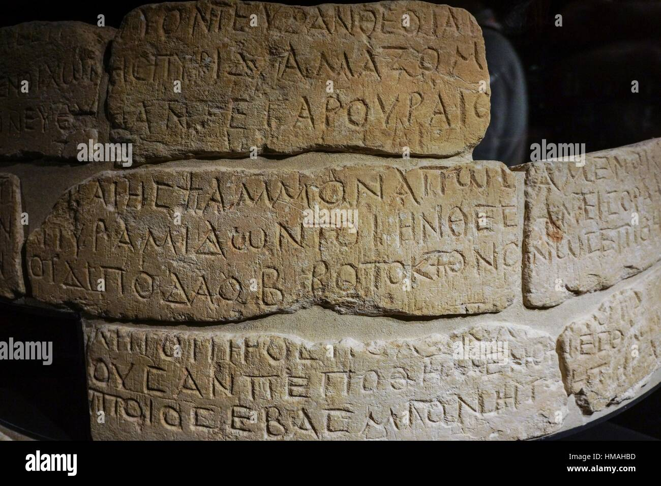 Egyptian reused column with Greek inscriptions. Louvre Museum. Paris. France. - Stock Image