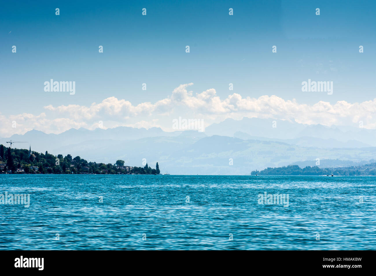 Lake Zurich with alps and blue sky background and landscape - Stock Image