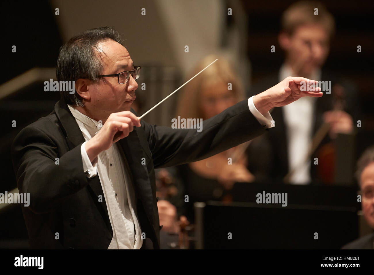 Conductor Shao-Chia Lü conducting at concert, Rhein-Mosel-Halle, Koblenz, Rhineland-Palatinate, Germany - Stock Image